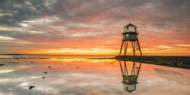 Sunrise behind the old lighthouse, in Dovercourt Bay