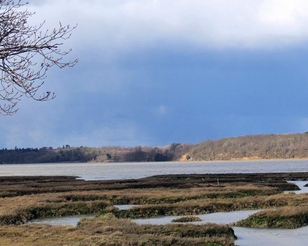 Photo showing landscape and a wide estuary