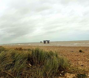 Mile 44 by Ali Fox: Wide shot of the deserted shingle beach near Sizewell B