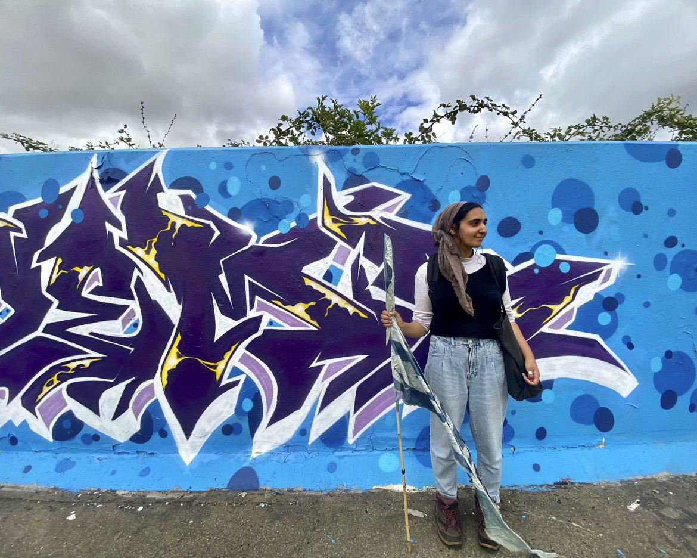Saira at the graffiti wall credit Kevin Rushby