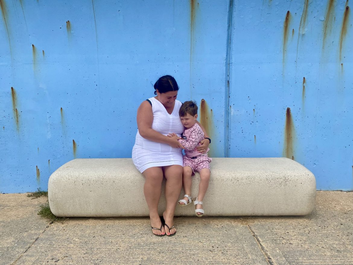 Mother and child on a bench near the sea wall on Canvey Island credit Kevin Rushby